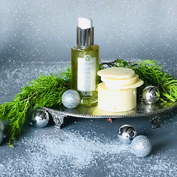 Soothing Body Oil on a silver platter with a cake of Lavender Shea Butter soap