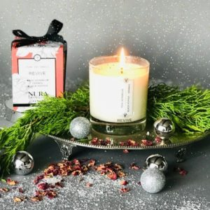 Lit Soy Wax candle on a silver platter with rose petalsil