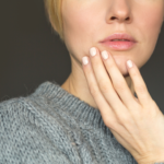 Woman with hand - looking for tips to help her skin feel better
